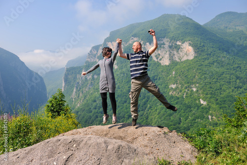 happy young couple jumping in the air