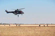 Helicopter And Soldiers In Act...