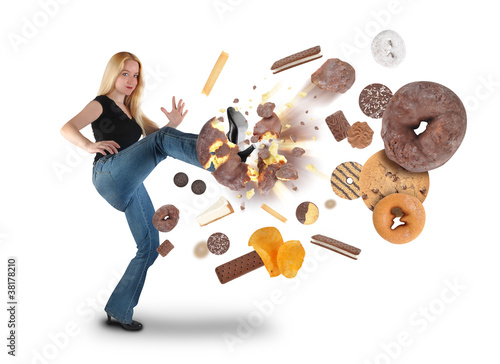 Fotografia  Diet Woman Kicking Donut Snacks on White
