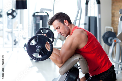 Deurstickers Fitness man with weight training equipment on sport gym