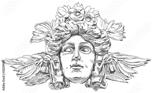 Photo Woman's face with olive branches and flowers woven into the hair