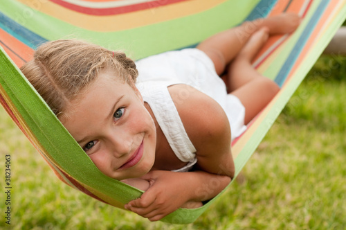 Photo  Lovely girl in colorful hammock