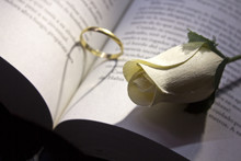 Gold Ring And Book A Romantic Heart Forming