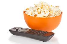 Popcorn In A Orange Bowl And Remote Control