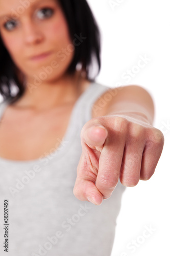 Fotografie, Obraz  Frau zeigt mit dem Finger