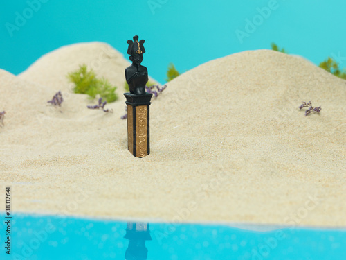 Spoed Foto op Canvas Turkoois egyptian scribe bust in miniature sandy landscape
