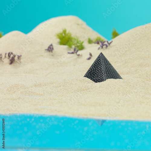 Spoed Foto op Canvas Turkoois pyramid showing from sand dune miniature landscape