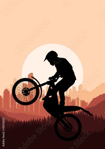 Fotografia Motorbike trial rider in skyscraper city landscape background