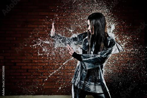 Obraz na plátně Woman Playing In Rain