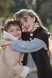 tender scene of two little girls hugging