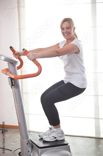 Fotografie, Obraz  Happy woman ath the gym