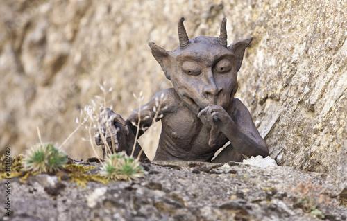 Photo  Small funny devil statue looking down, La Couvertoirade, France