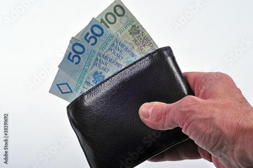 Fototapeta Portfel z banknotami w ręku obraz