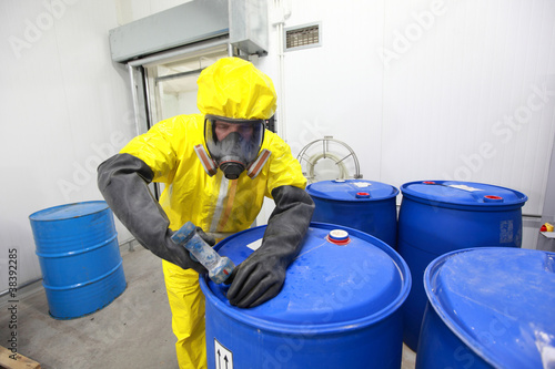Fototapeta Professional in uniform dealing with chemicals obraz