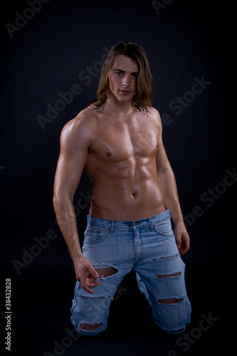 Fotografie, Obraz  Muscular male body on black background