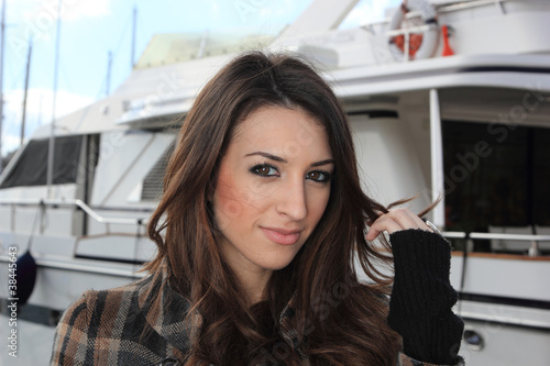 Fototapety, obrazy: Young woman at the port