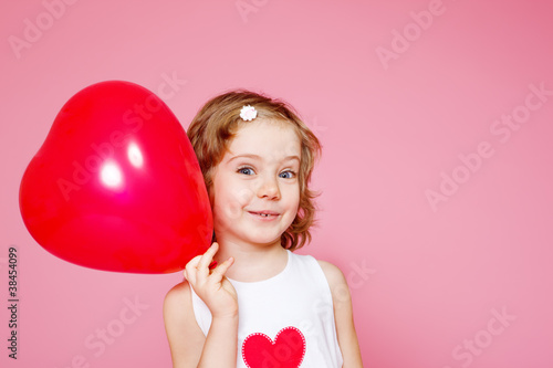 Photo  Girl with a red balloon