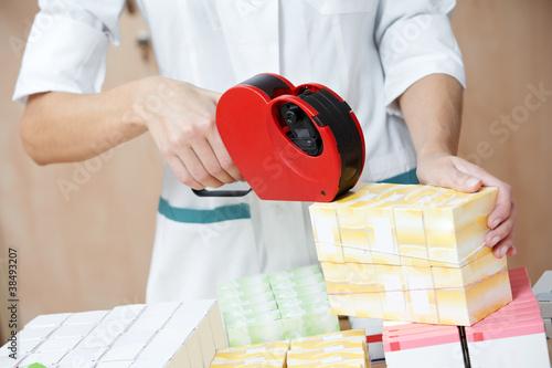 Fotografie, Obraz  Pharmacy chemist woman labeling drugs