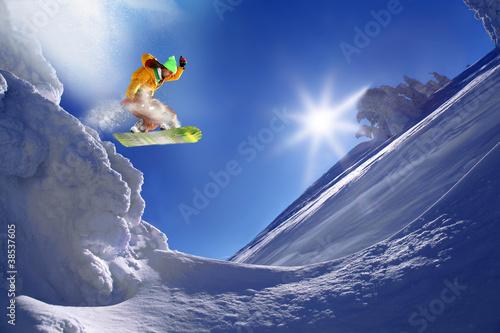 Foto-Stoff bedruckt - Snowboarder jumping against blue sky (von Tomas Marek)
