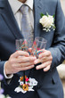 Groom holding painting wedding champagne glasses