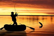 Fishermen In Boat At Sunset