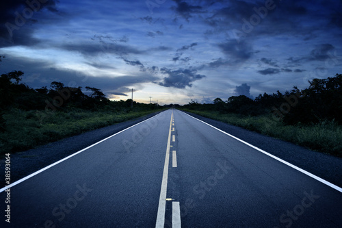 Remote road at sunset Wallpaper Mural