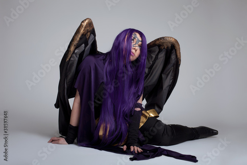 Photo girl sit in purple fury cosplay costume character