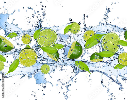 Tuinposter Opspattend water Fresh limes in water splash,isolated on white background