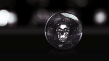 Skull In Dark Glass Ball With ...