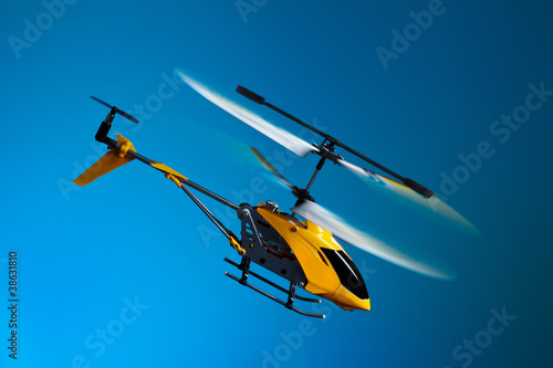 Tuinposter Helicopter Flying remote controlled helicopter