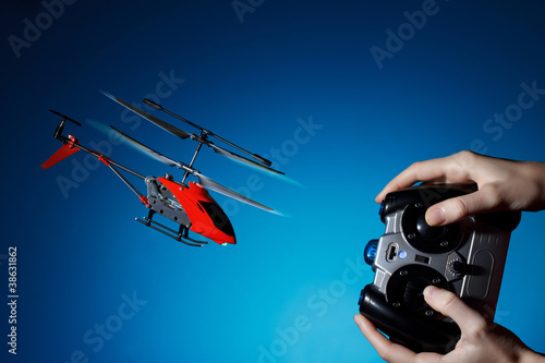 Tuinposter Helicopter Piloting remote control helicopter
