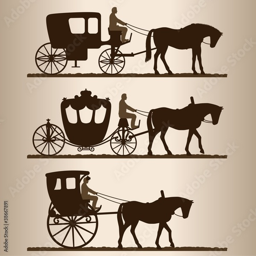 Foto Silhouettes of horse-drawn carriages with riders.