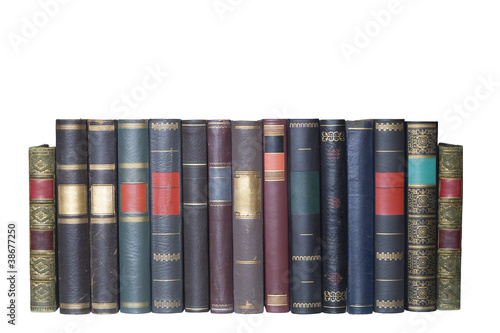 Fényképezés  vintage books in a row, isolated on white background, blank labe