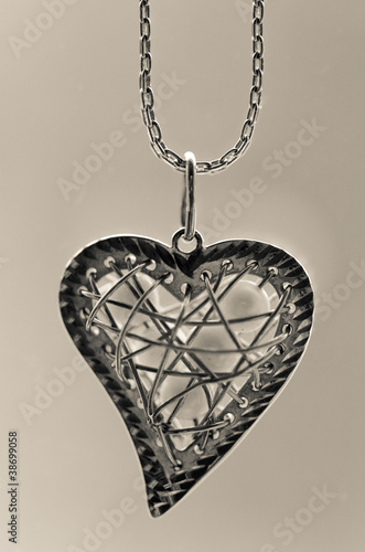 Valokuva Silver pedant in the shape of a heart