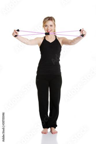 Plakat Młoda atrakcyjna kobieta ćwiczenia