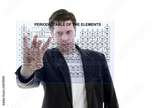 Photo  Male with Pereodic Table of Elements on touch screen