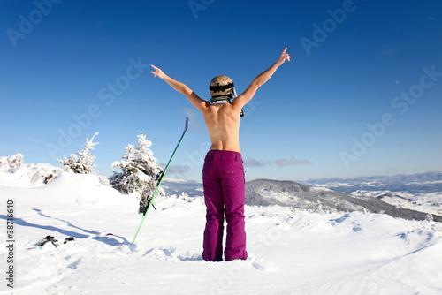 Fotografie, Obraz  Rear view of female skier posing topless on mountain slope