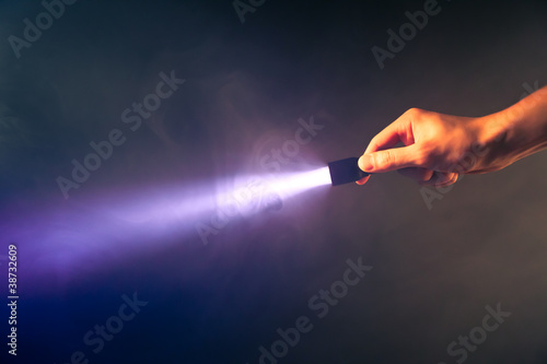 glowing pocket torch light Fototapet