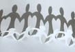 Paper people chain forming heart between figures