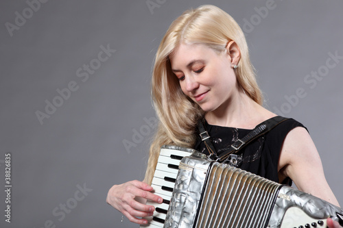 Fotografia, Obraz  Beautiful young woman with an accordion.