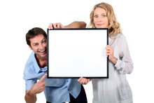 Couple Holding Blank Picture F...