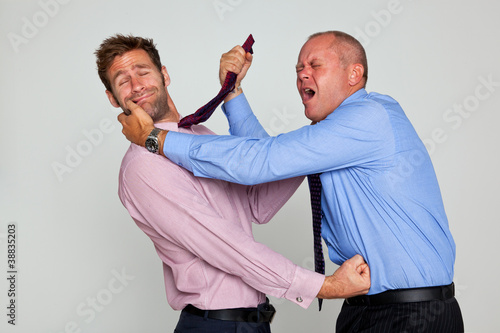 Two businessmen fighting Wallpaper Mural