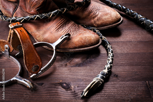 Fotografia, Obraz  Cowboy boots,whip and spurs on wood
