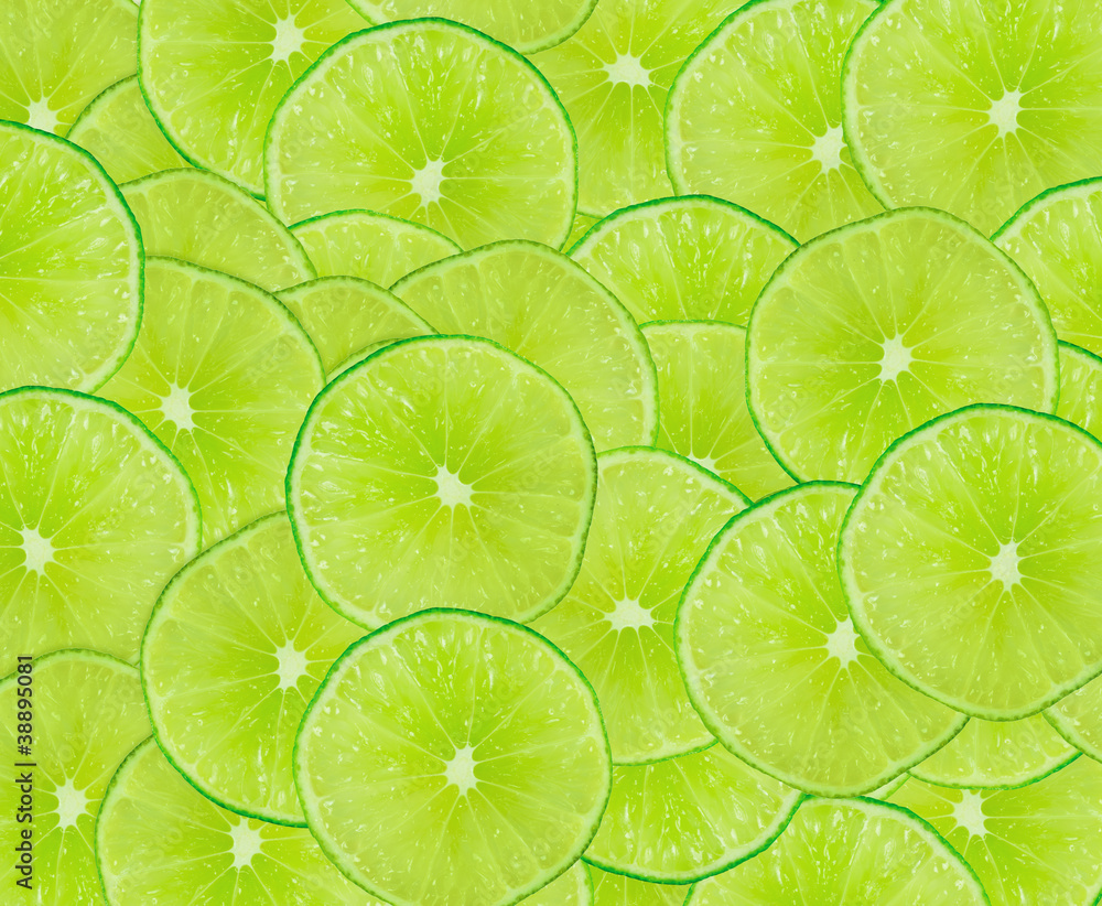Fototapety, obrazy: Lime slices background with a space for text