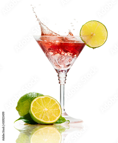 Poster Splashing water Red martini cocktail with splash and lime isolated