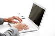 Businessman working at laptop computer, white background