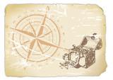 vergilbtes Papier mit Kompass und Schatzkiste