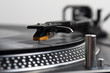 Record spinning on a turntable - focus on the needle