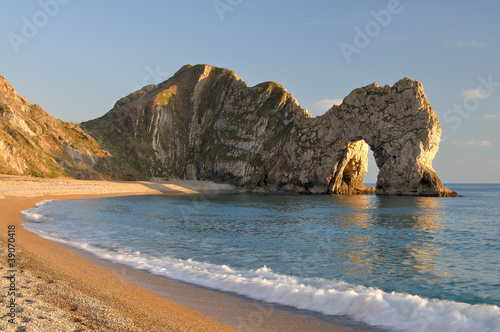 Late evening light at Durdle Door Lulworth Dorset England. Poster