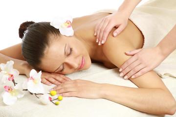 Obraz na płótnie Canvas An attractive woman getting spa treatment
